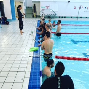 Go Freediving Surf Survival Course students in pool listening to Heather cc