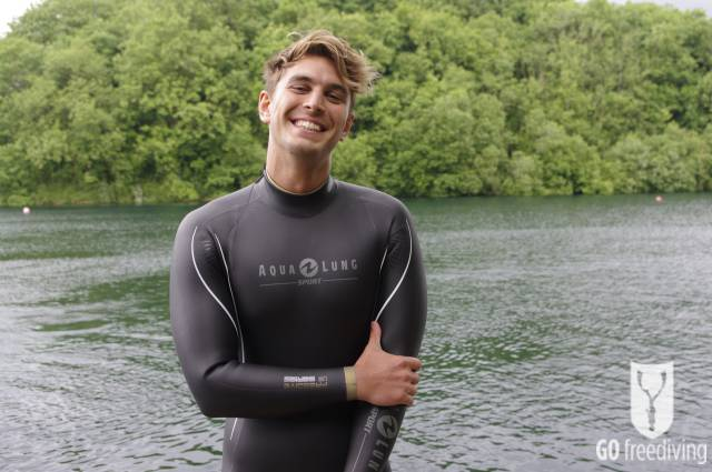 Carl Atkinson wearing Aqua Lung Sport Apnea Freediving suit at Vobster Quay for Go Freediving mid shot laughing for freediving training plan