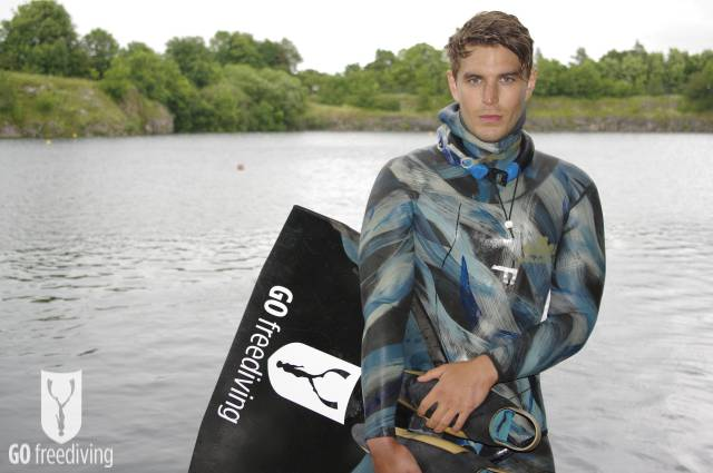 Carl Atkinson wearing Elios Freediving warm-up Competition suit at Vobster Quay with Go Freediving Monofin, neck weight, fluid goggles and nose clip 2