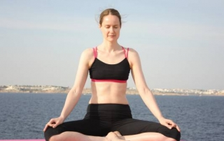 How to do kapalabhati, the pumping breath, or shining skull yoga breathing exercise with Emma Farrell