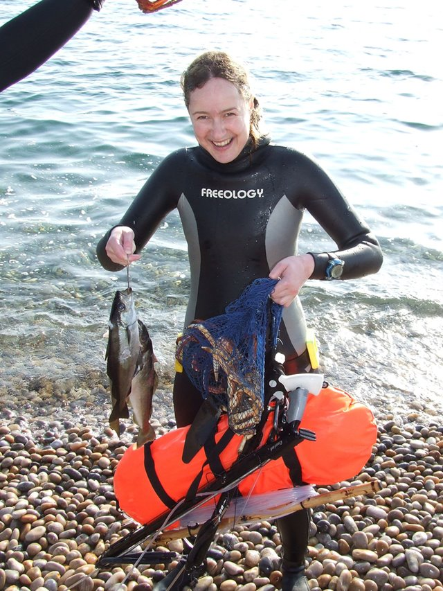 Spearfishing Courses, Emma Farrell with fish, crab and spearfishing gear