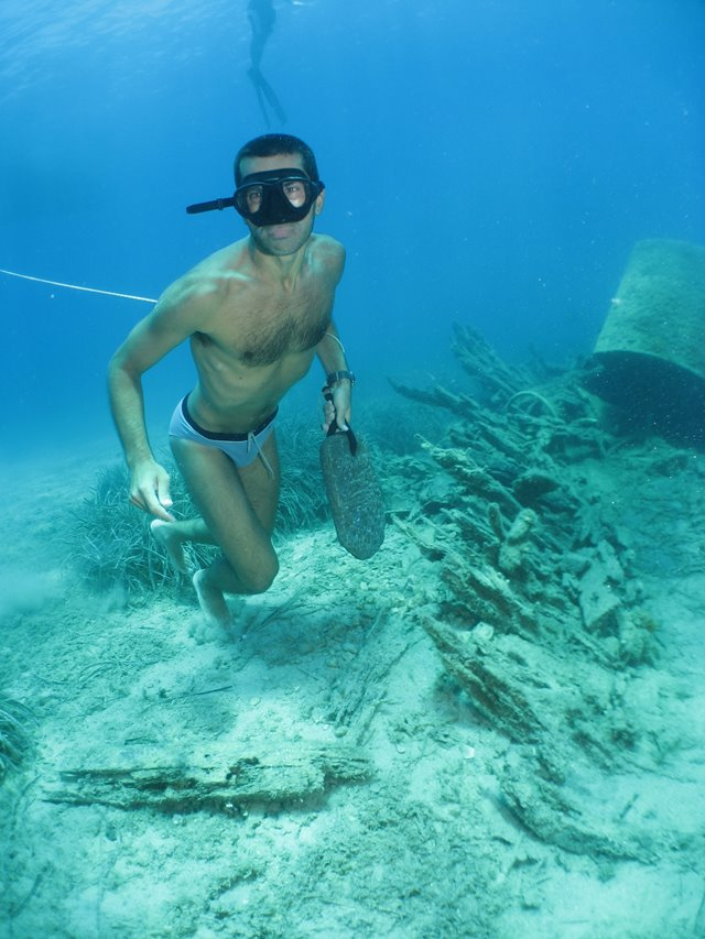 Freediver with a sponge diver
