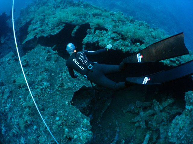 Freediver exploring the wreck of the Dunraven in the Red Sea, Egypt