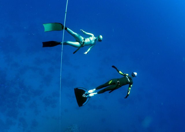 Emma Farrell and freediver with monofin freediving in Red Sea, Egypt