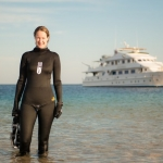 Emma Farrell, freediver, in the Red Sea with the ship Mistral in the background